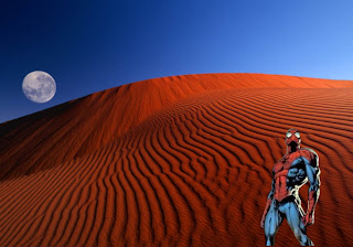 Spiderman  Super Heroe Wallpapers Standing Tall in Classic Red Moon Desert background