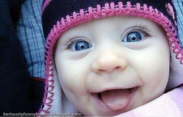 Super Cute Baby with Blue Eyes and tongue out smiling!