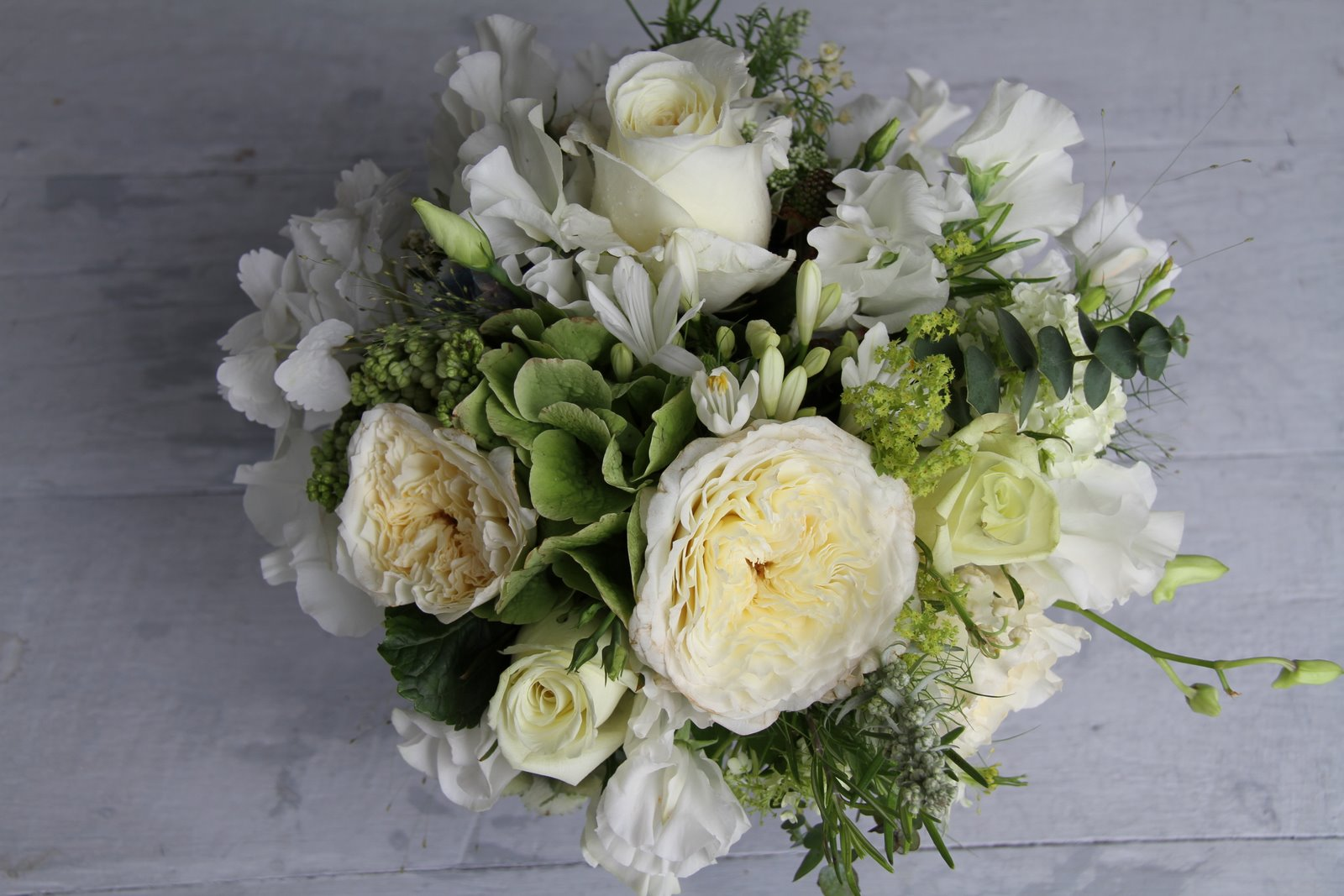 The Flower Magician White With A Hint Of Blue Green Wedding Bouquet
