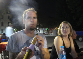 Blowing smoke from a Shisha water pipe.