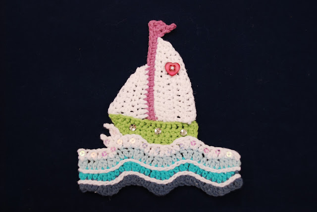 image of crocheted sailboat on waves