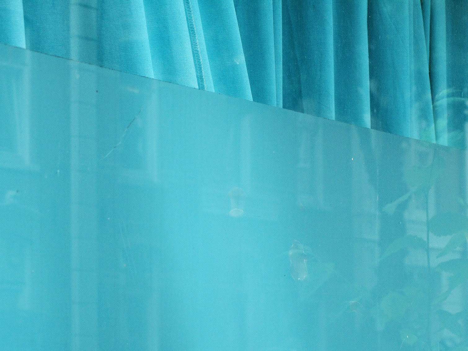 blue curtain in the window