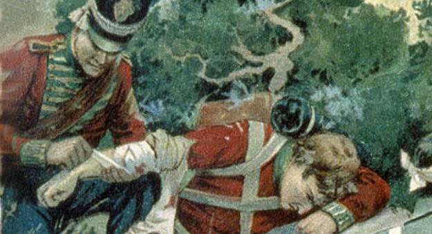 Colour painting of two men in red coats, one is bandaging the injured Macdonell's arm.