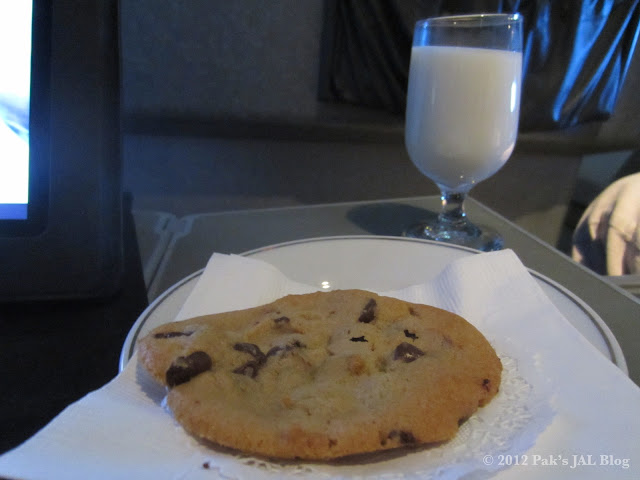 Freshly baked on board cookie and milk