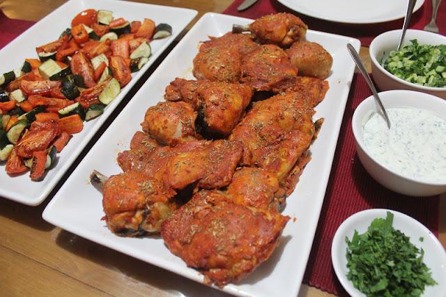Serve tandoori chicken with roasted vegetables, naan, cucumber sambal ...