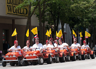 Shriners in their little orange cars participating in a Canada Day Parade
