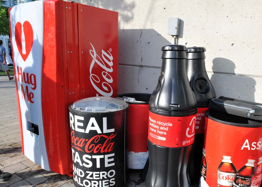 hug me coke machine location