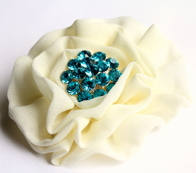 white hair flower with turquoise rhinestone - catherine masi / summer 2013