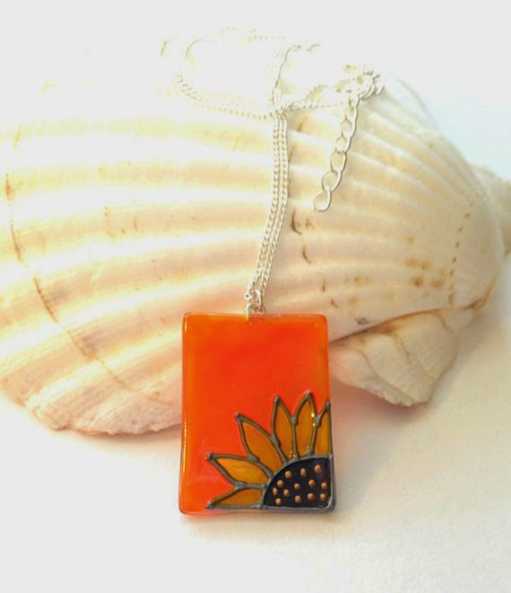 https://www.etsy.com/listing/196845220/glass-pendant-in-orange-with-a-sunflower?ref=favs_view_10