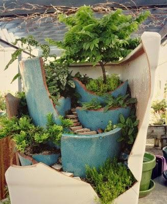 عمل تجميل للاواني المكسورة broken-pot-fairy-garden-10-327x400.jpg