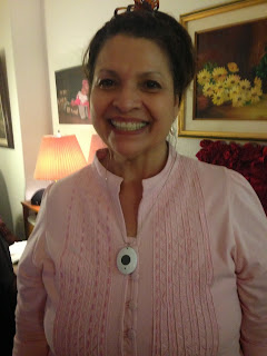 picture of author's mom smiling wearing a small pendent around her neck - the mobile medical alert device