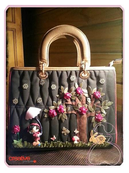 Bolso de mano decorado a mano por Sylvia Lopez Morant