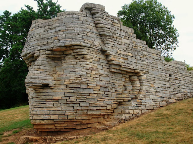 Giant Chief's Head Busts Out of Wall