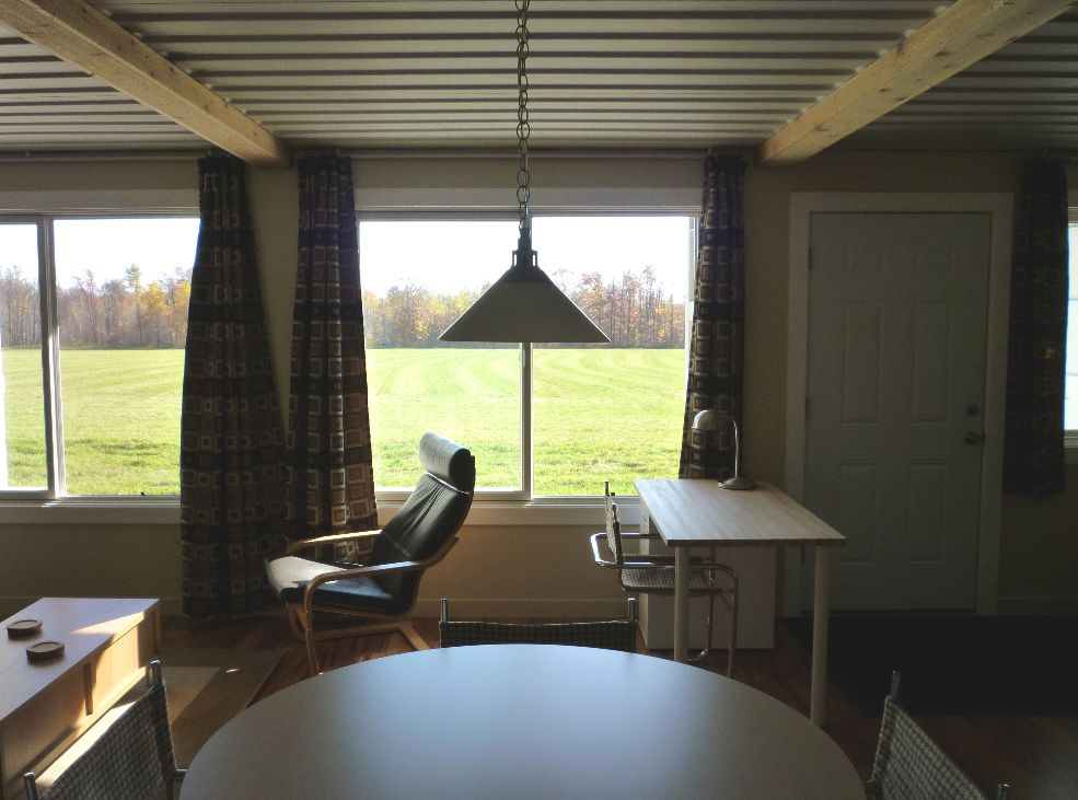 Sense and simplicity shipping container cabin update for Village craft container home