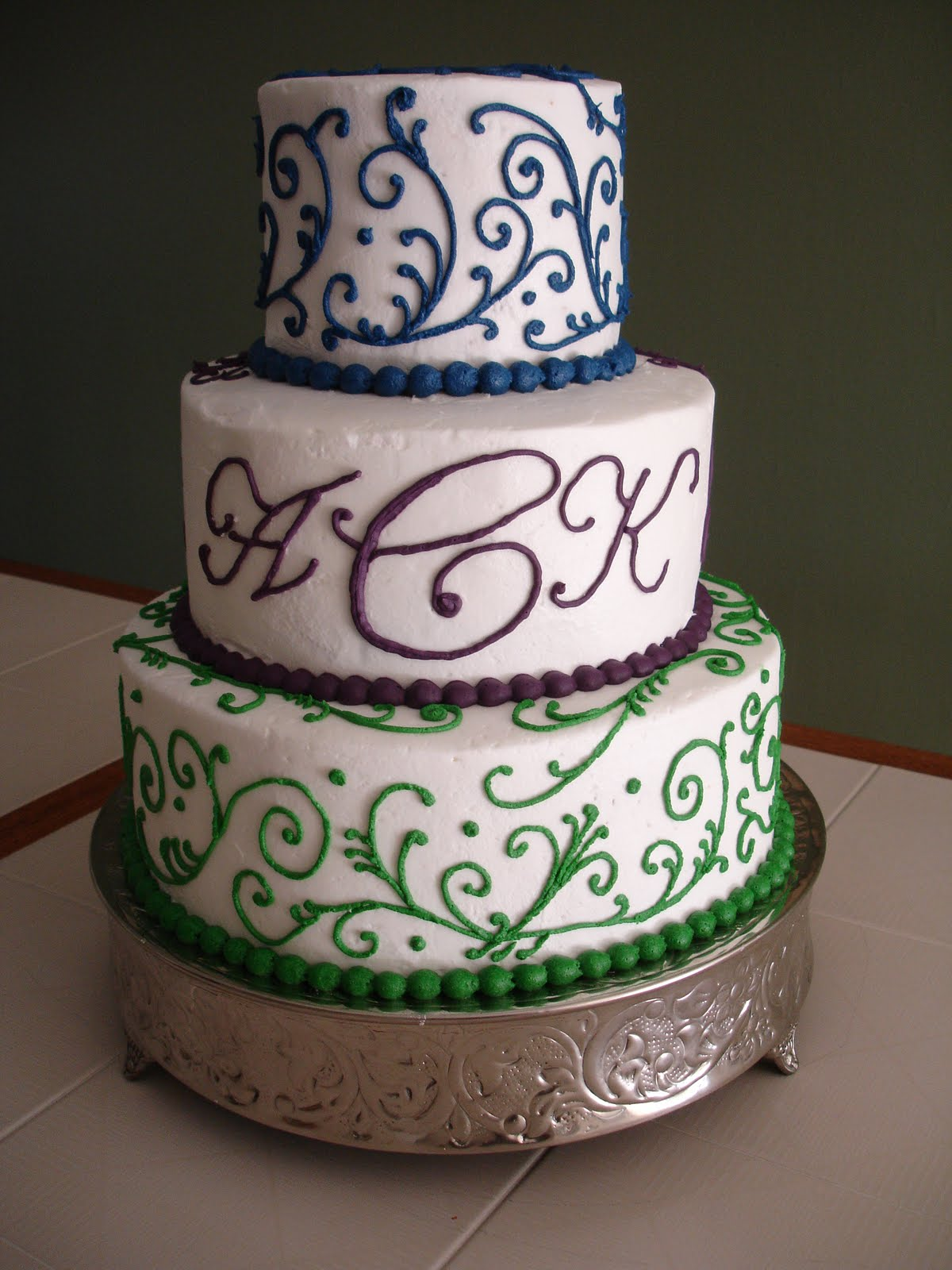 Cake Flair Swirls Wedding Cake and A Helper