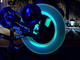 glowing art created by consistently spinning tires that have glow sticks on them
