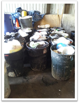 Buckets of categorized trash and recyclable items