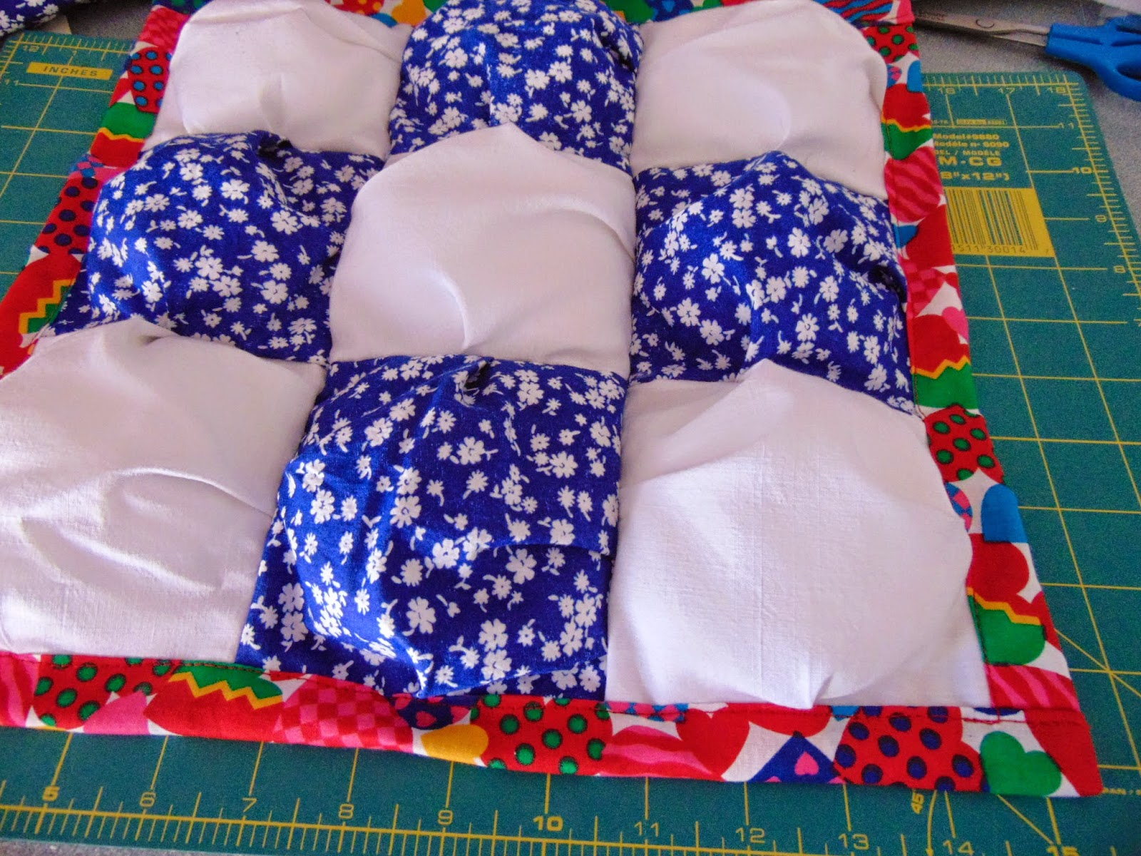 Blue and White Alternating Squares with Colorful Backing Binding