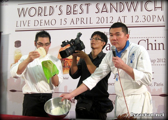 Chef Hubert Ly and Darren Chin doing their thing, with the videoman taking real time shots of the process