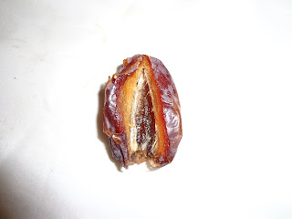 pitted cut open jumbo medjool date