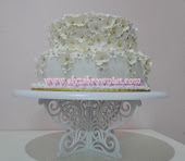 Stacked wedding f0ndant cake