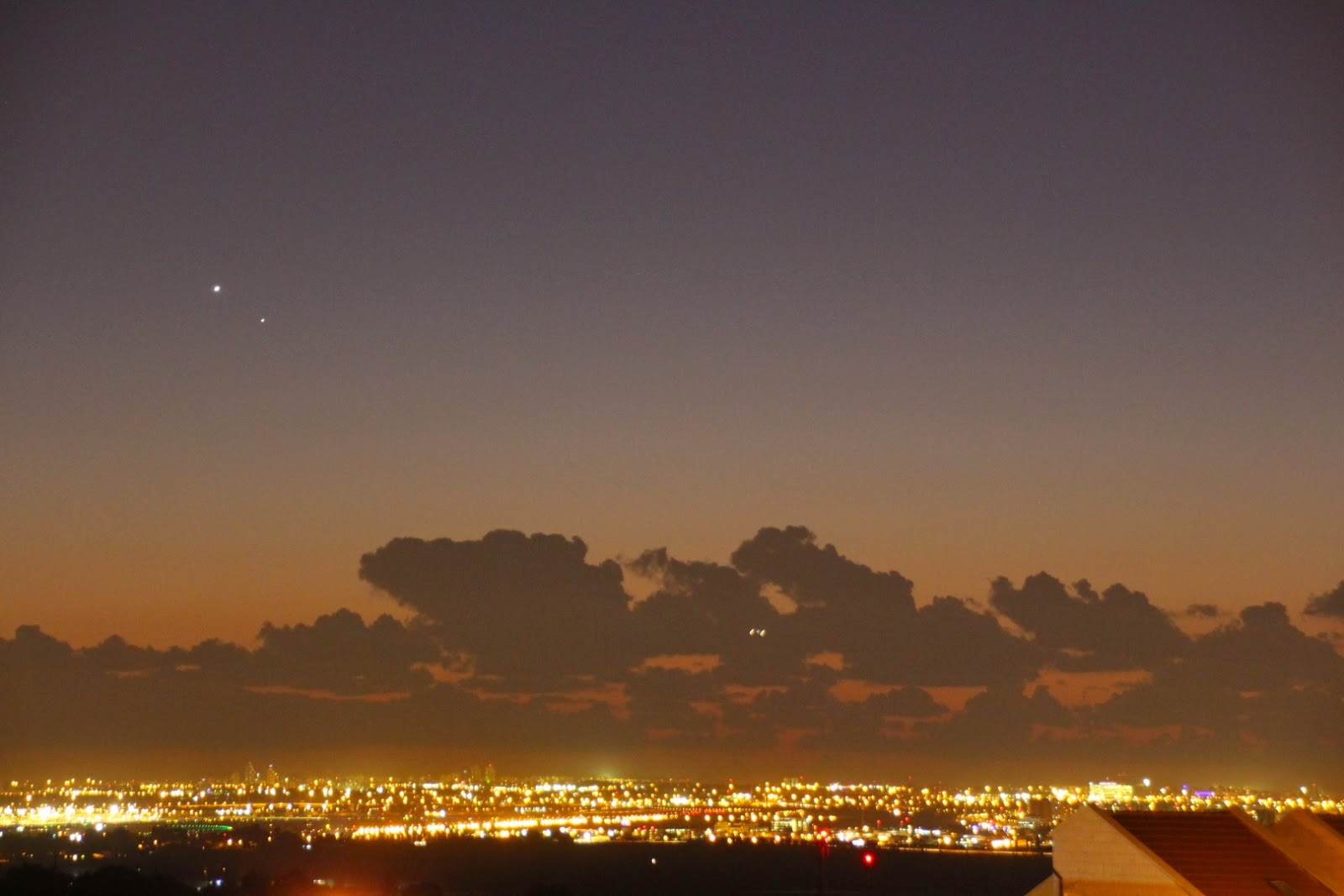Venus, Mercury and an airplane taking off