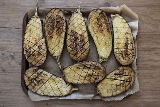 A baking tray filled with grilled aubergines