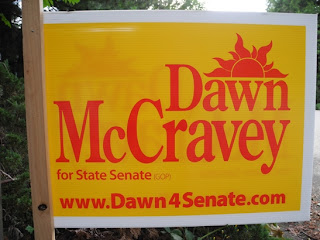 A Dawn McCravey sign. The larger ones aren't any easier to find her party on.