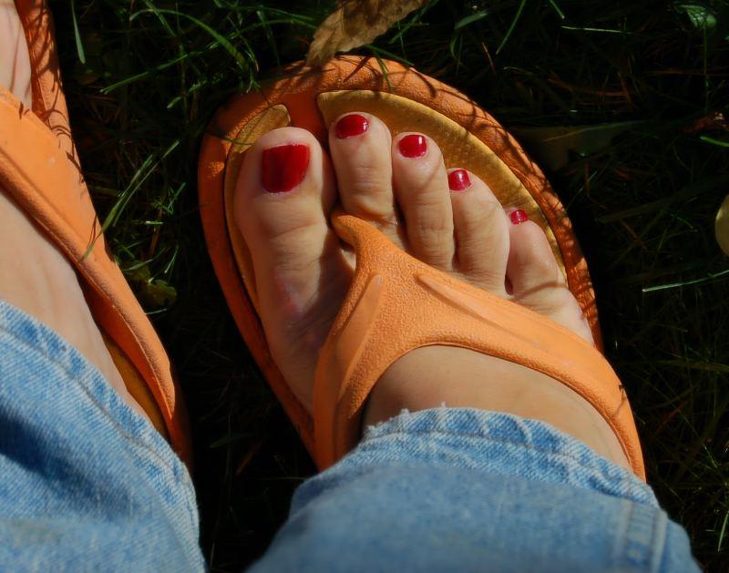 Mens toes with nail polish