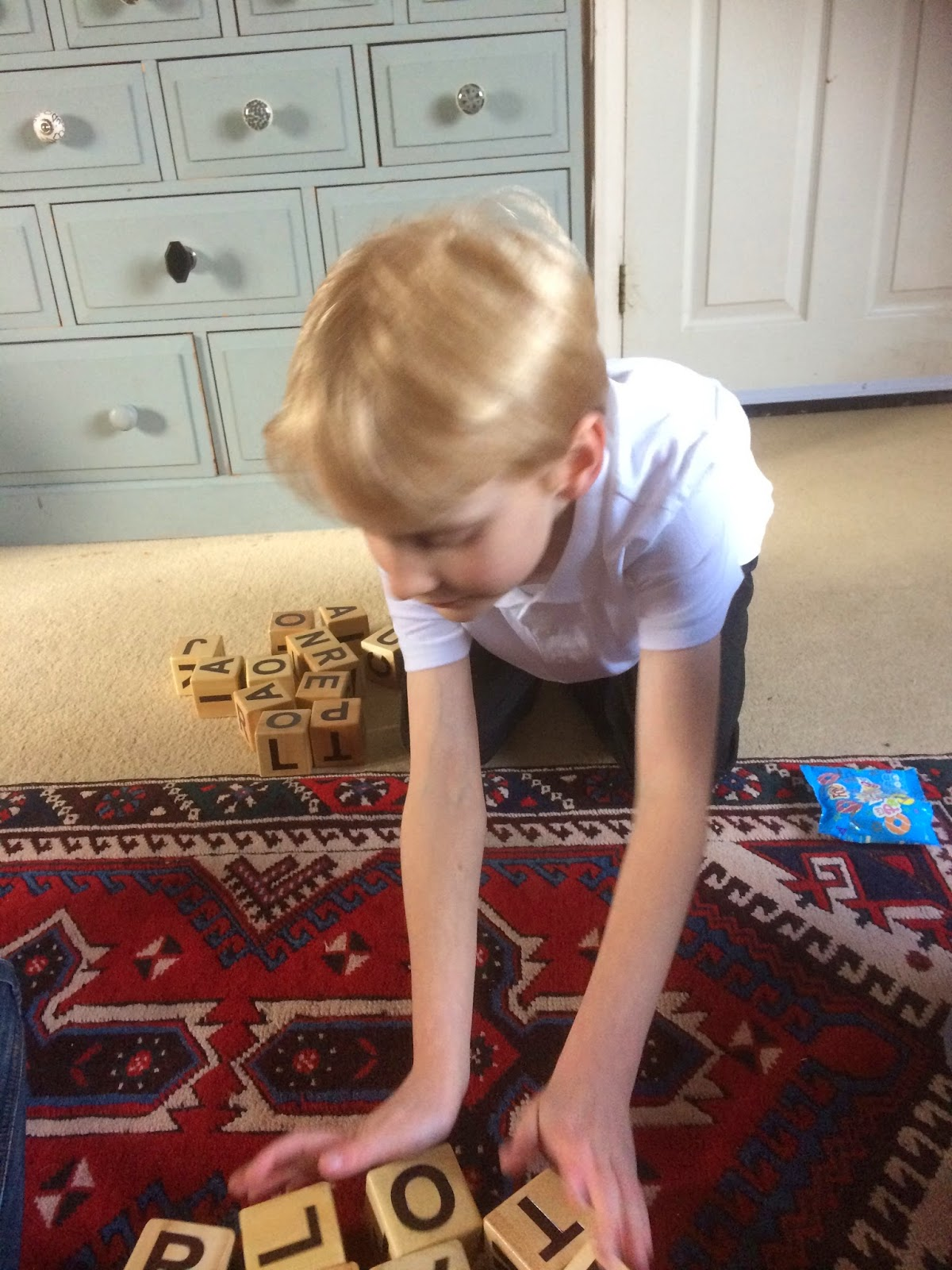 boy playing Bananagram Jumbo Zip-it