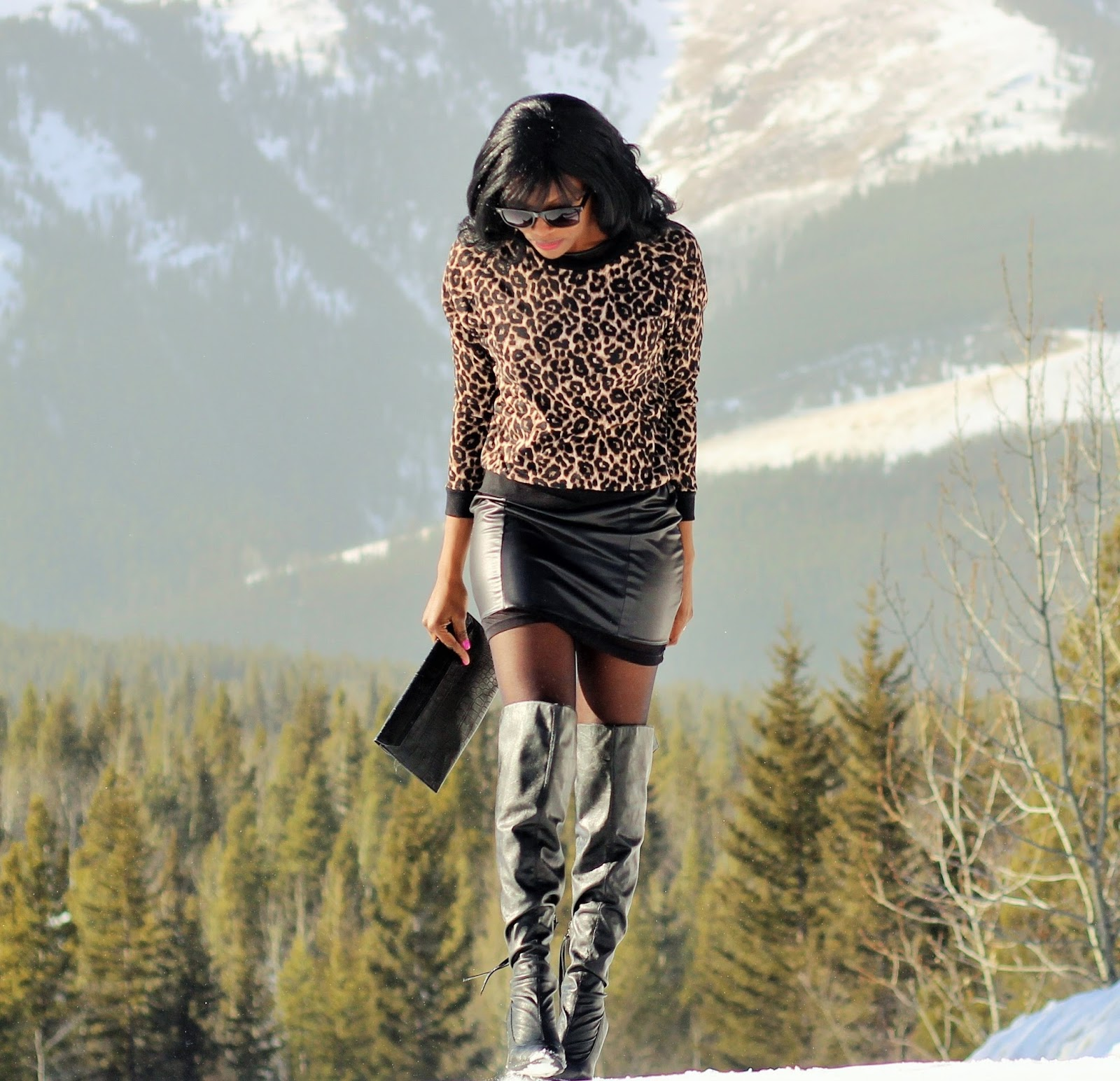 Animal print top styled with over the knee boots