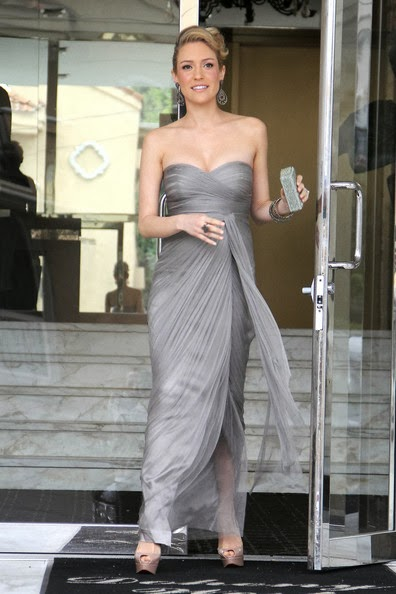 A pregnant Kristin Cavallari looked lovely as she was seen emerging from her Los Angeles condominium ahead of the 84th Annual Academy Awards in a light gray bandeau floor-length chiffon gown featuring a sweetheart neckline and draped detailing.