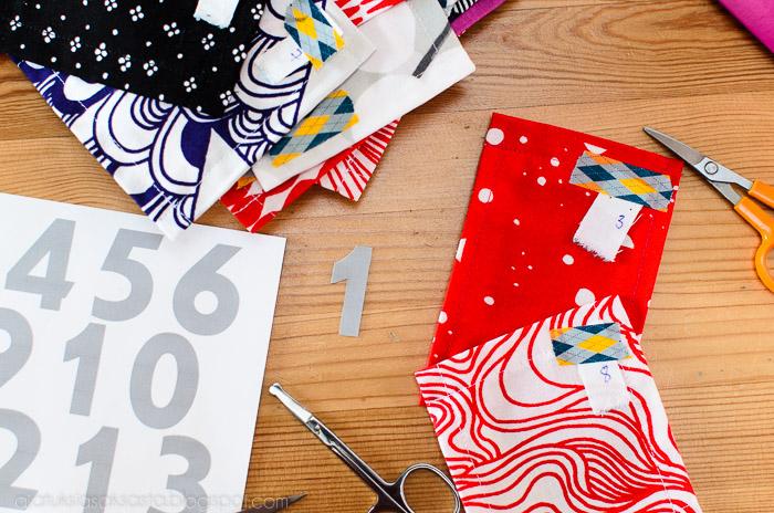 taskullisen joulukalenterin ompelu, numerot tulostinkalvosta