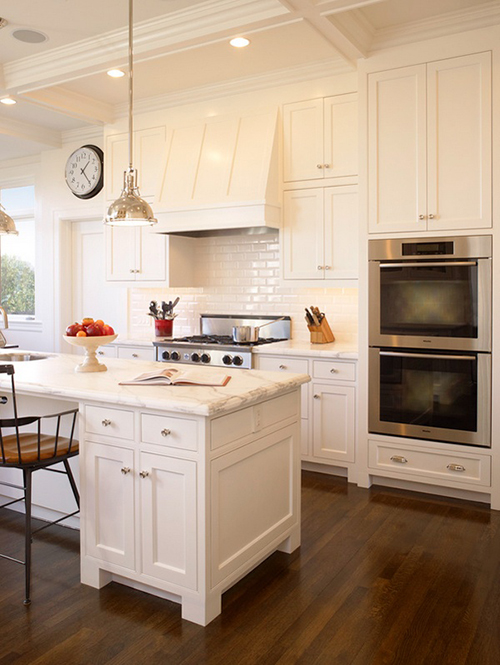 The peak of tr s chic white kitchens marble vs quartzite for Shaker style kitchen hoods