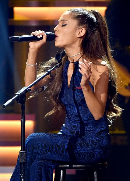Ariana Grande performs in a blue jumpsuit at Stevie Wonder's All Star Grammy Tribute in LA