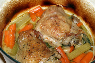 Overhead of turkey and vegetables in Dutch oven, after braising.