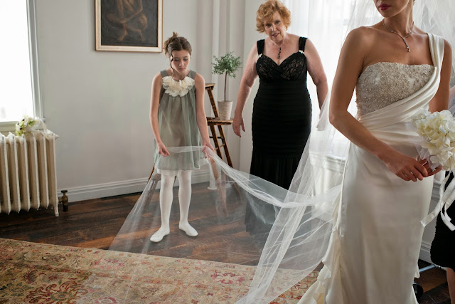 A Model Wedding, veil touch ups in the sunlight with mom and niece