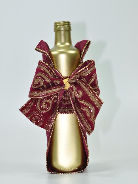 Garrafa dourada natalina