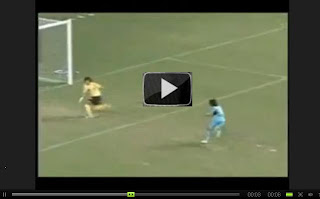 Funny football sports player | A funny goal keeper missing the goal near goal post