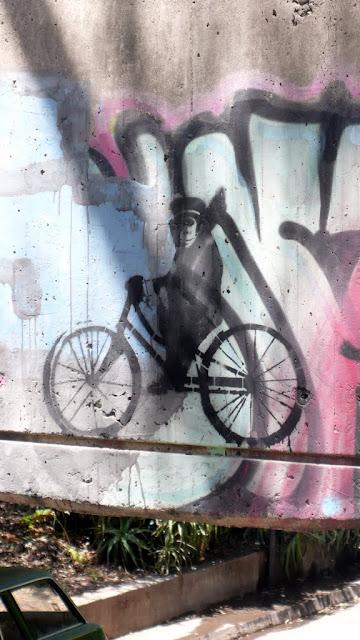 street art in santiago de chile stencil arte callejero monkey on a bike