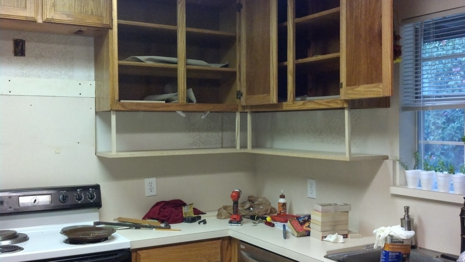 Fix lovely how to build shelves under your kitchen cabinets for Caulking around kitchen cabinets