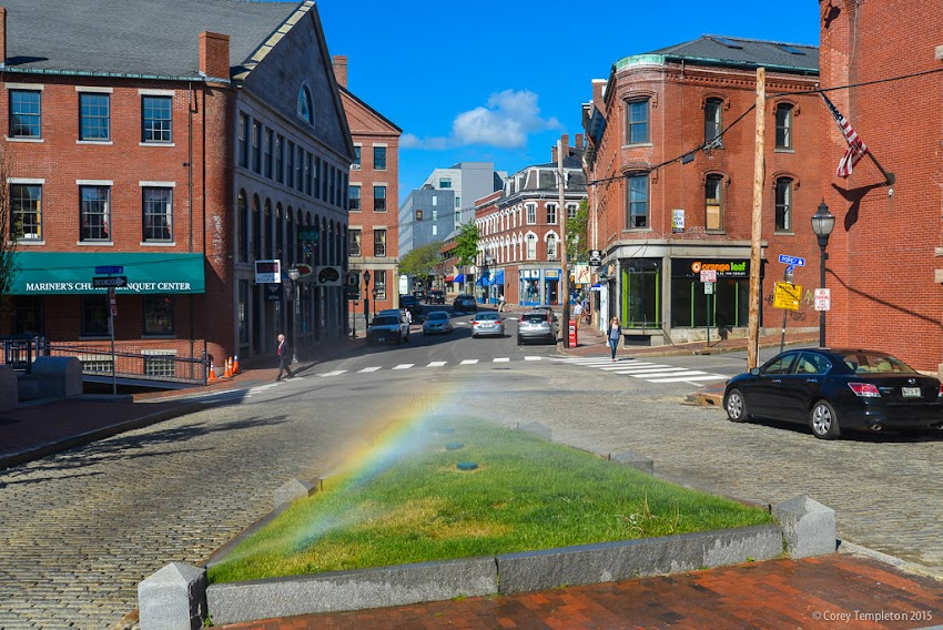 Portland, Maine May 2015 Summer in Old Port with rainbow from sprinklers on Fore Street. Photo by Corey Templeton.