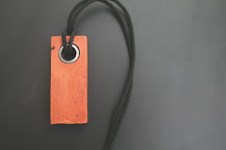 Brick found in Detroit and turned into a pendant.