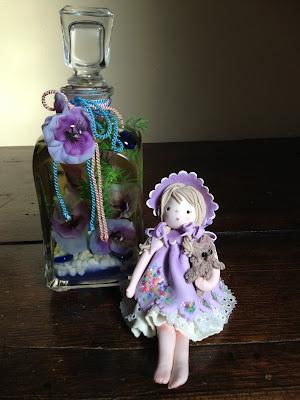 Bambola mais o porcellana a freddo lilla