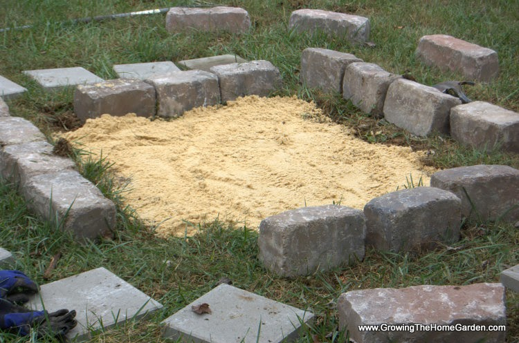 Add a base layer of sand underneath the pit for stonework.
