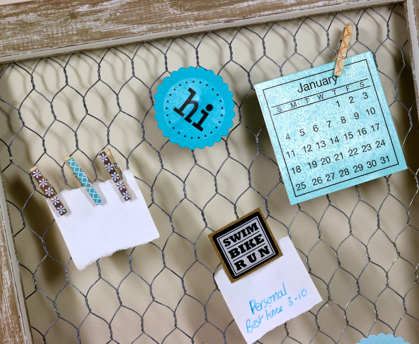 SRM Stickers Blog - Chicken Wire Bulletin Board by Cathy A. - #altered project #homedecor #calendars #stickers #punched pieces #twine #2015 #embossed kraft bags #DIY