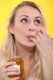 Blonde Woman Tasting Syrup