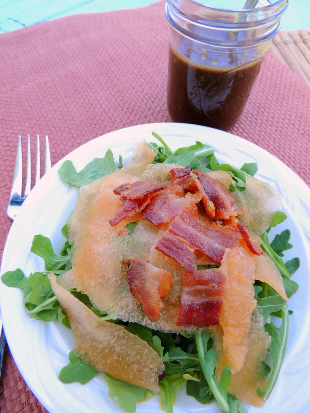 Bacon, Cantaloupe, and Arugula Salad with Bacon Balsamic Dressing via thefrugalfoodiemama.com