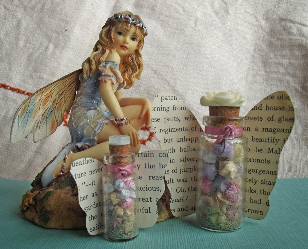 Fairy statuette figurine statue glass vials button resin rose ribbon rose gold glitter pastel colour quilling paper origami lucky stars wishes book page butterly wings