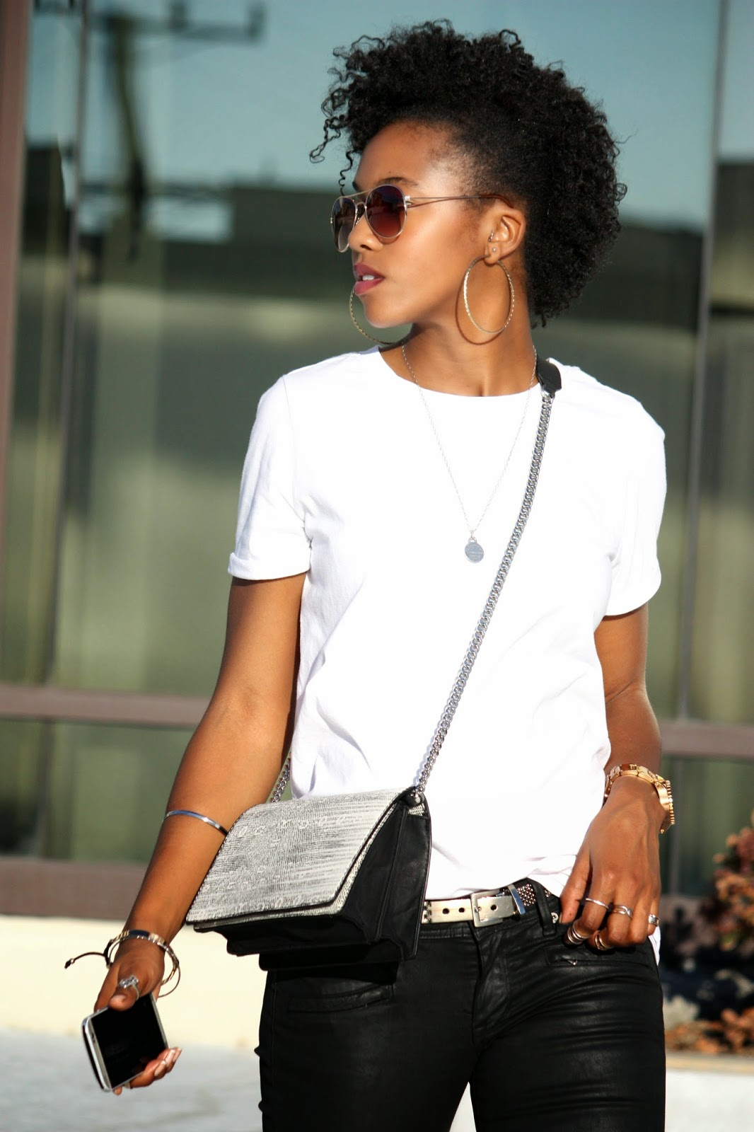 Wearing H&M sunglasses Tiffany & Co oval pendant necklace with a Nixon rose-gold watch